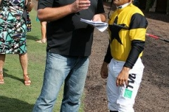 Trainer and Jockey decide on a plan for the race.